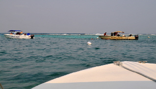 Boats anchored at snorkeling site