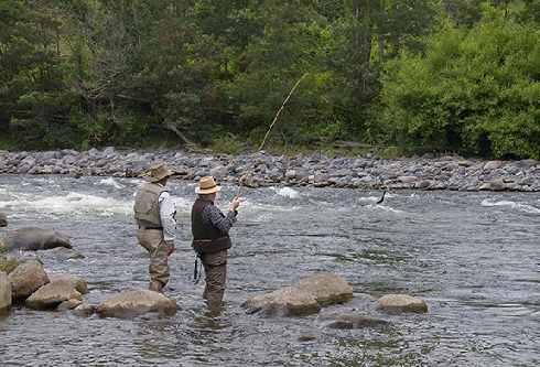 Jim guiding Michael to a trout